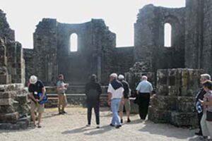 Delegates led in Breton through the old Landevennec Abbey ruins Kemper